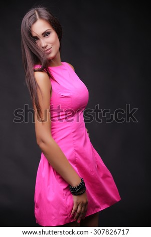 Very attractive women/girl. fashion design. shot in studio. Girl has black hair and cool smile. professional model.  - stock photo