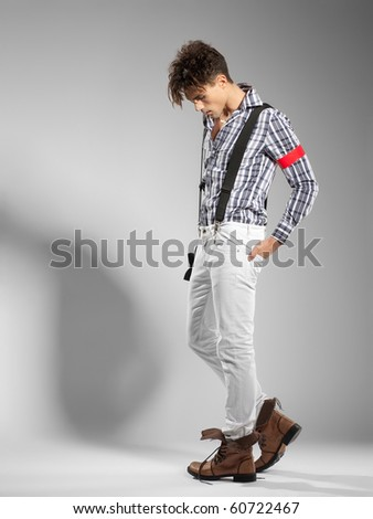very attractive young male model looking away - clean studio shoot - copy space - stock photo