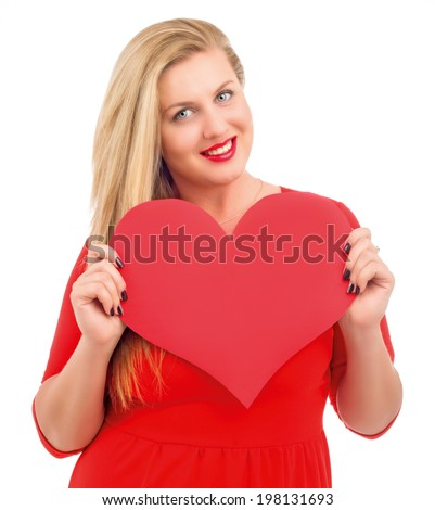 very beautiful blond woman holding a big heart, isolated against white background (Valentine's day theme) - stock photo