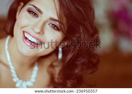 Very beautiful brunette girl with brown eyes smiling and happy, close up - stock photo