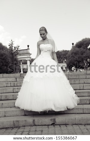 Very beautiful brunette in a wedding dress - stock photo