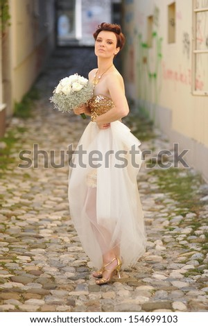 Very beautiful brunette in a wedding dress. Retro style  - stock photo