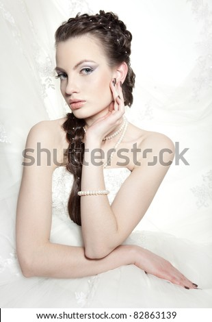 Very beautiful girl the bride, with the imposed make-up and a hairdress - stock photo