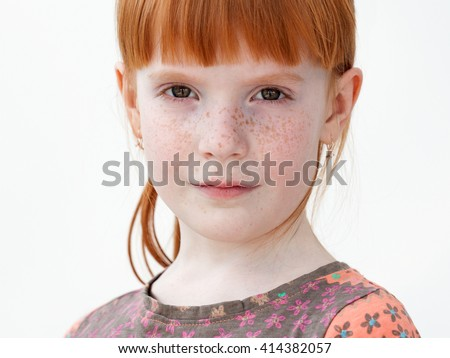 Very beautiful red-haired little girl with freckles serious, close up, isolated on white background - stock photo