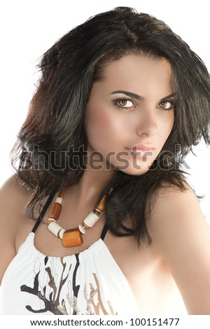 very beautiful sensual woman with long black hair sunglasses and stone necklace in fashion swimsuit, close-up portait when she looks in to the lens - stock photo