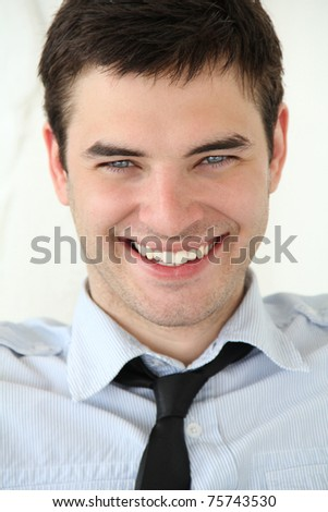 Very beautiful smile on the face. Portrait of handsome young men with blue eyes and white teeth - stock photo