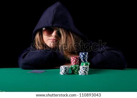 Very beautiful woman playing texas hold'em poker - stock photo