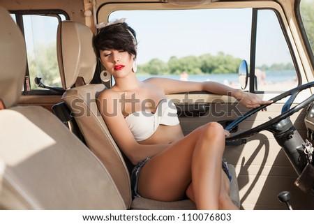 Very beautiful woman relaxing in car near the beach - outdoors - stock photo