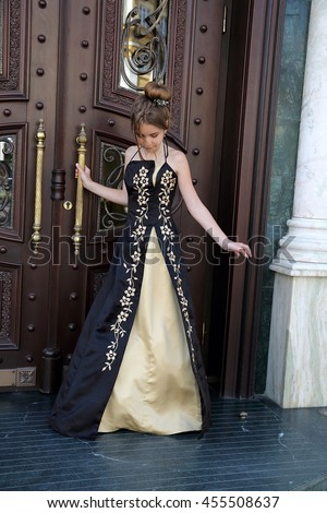 Very beautiful young girl Ukrainian European appearance in a long elegant black dress princess romantic pensive blonde babe dreaming of a prince - stock photo