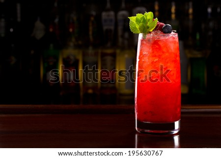 very berry cocktail on the bar - stock photo
