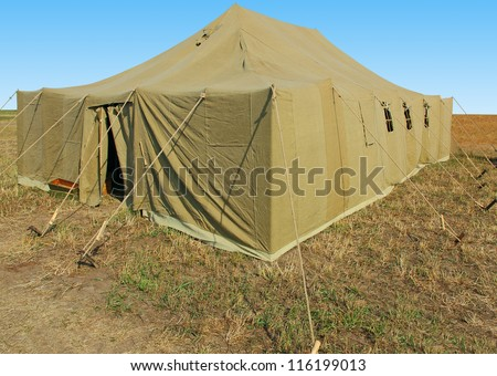 very big military tent in the field - stock photo
