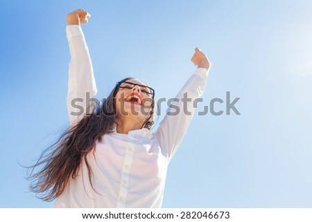 very cheerful business woman celebrating victory - stock photo