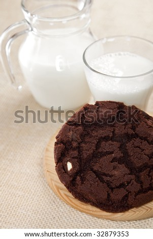 very chocolate chip cookie with milk  rustic style, shallow DOF - stock photo
