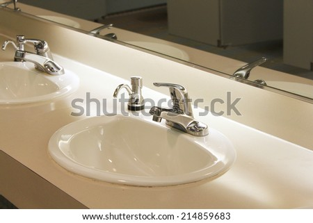 Very clean sinks in public bathroom - stock photo