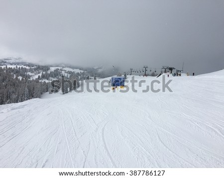 Very cloudy day in Italian Alps on the slopes. - stock photo
