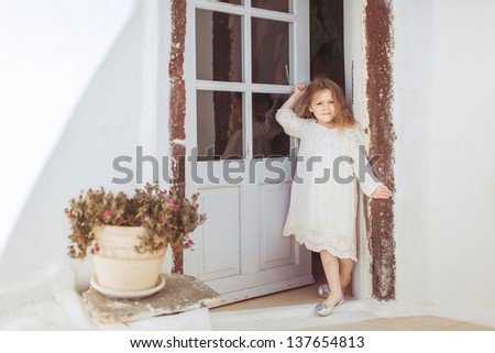 Very cute little princess outdoors in city street - stock photo