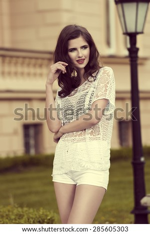 very cute model , in a fashion portrait out door , in an old style park , with vintage color effect - stock photo