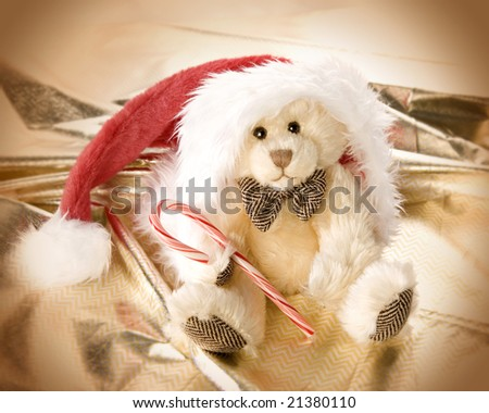 Very cute teddy bear in Santa's hat - stock photo