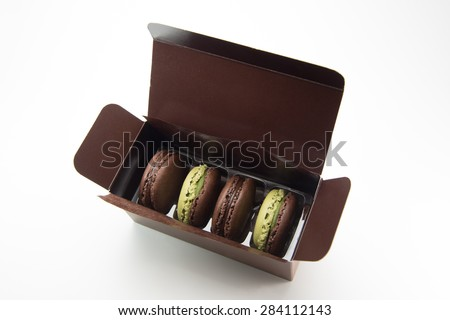 Very Delicious Japanese Green tea and chocolate flavor Macarons on white background - stock photo