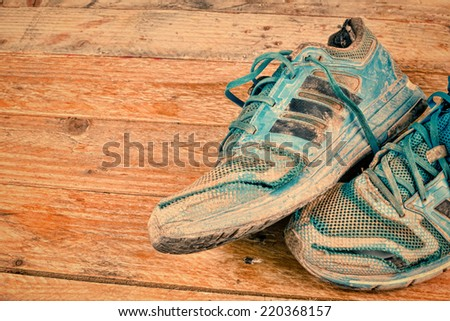 Very dirty and worn out sports shoes - stock photo