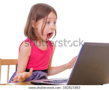 Very emotional girl sitting at a laptop. Isolated on white background. - stock photo