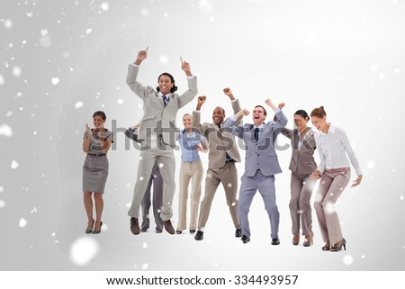 Very enthusiast business people jumping and raising their arms against snow - stock photo