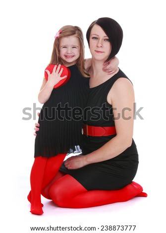 Very fashionable mother and daughter in beautiful clothes. Isolated on white background studio photo. - stock photo