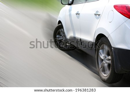 Very fast driving car on road - stock photo