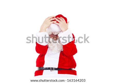 Very frustrated Santa Claus due to lot of work - stock photo