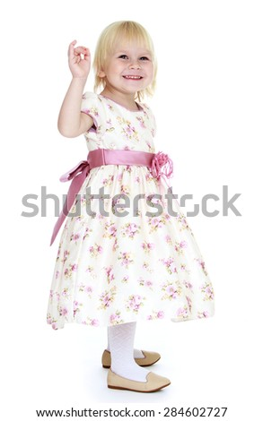 Very gentle little blonde girl in a beautiful long dress- isolated on white background - stock photo