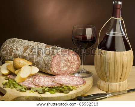 very good Italian salami, is waiting to be eaten with bread and red wine - stock photo