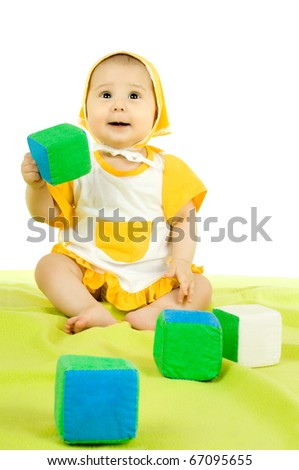 very happy, beautiful,  joy, little kid , lie on stomach and play with brick  on white background - stock photo