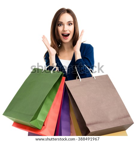 Very happy beautiful young woman in casual clothing with shopping bags, isolated over white background - stock photo