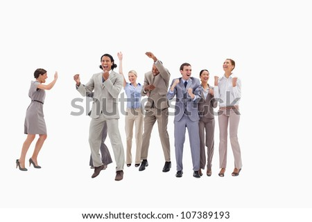 Very happy business people jumping and clenching their fists against white background - stock photo