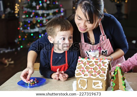very happy dude / checking out the gingerbread / as the young kids do - stock photo