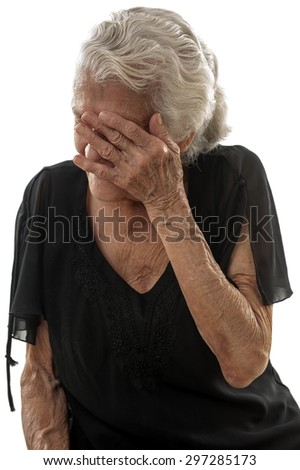 Very happy Senior smilling and covering her face. - stock photo