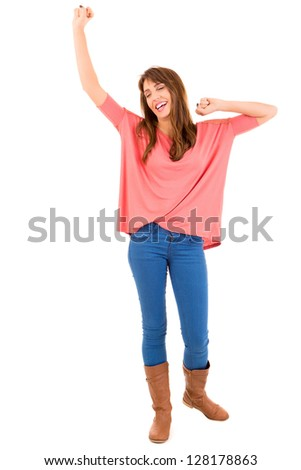 Very happy woman raising her arms and celebrating - stock photo