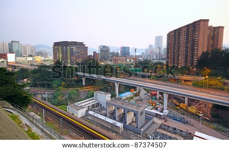 very high-speed train go through the city - stock photo