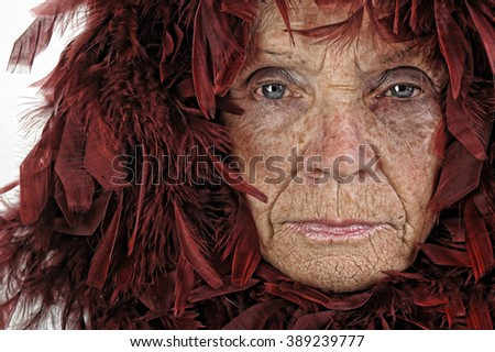 Very Interesting Image of a Old woman and feathers - stock photo