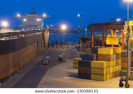 very large ship in the port during cargo operation - stock photo