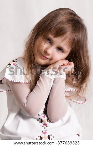 Very lovely,cute,adorable girl.Beautiful,attractive,nice little girl.Cute kid.Really beautiful,pretty little girl.Little Princess.Little girl looks interesting,shy.Portrait of fashionable little girl - stock photo