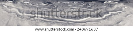 very mysterious and fantastic at sunrise, sunset and moonlight snow space of high mountains Ukraine- Ukrainian Carpathians, carved by the winds, blizzards, storms and snowfall in decorative patterns - stock photo