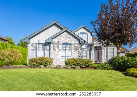 Very neat and tidy home with gorgeous outdoor landscape in suburbs of Vancouver, Canada  - stock photo