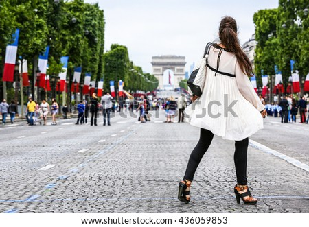 Very nice parisian girl in Paris on Champs Elysees avenue - stock photo