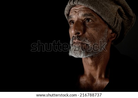 very Nice portrait of a afghan man on Black - stock photo