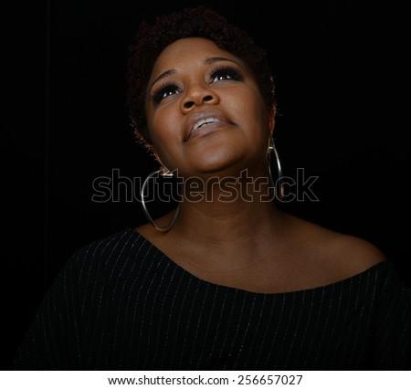 Very Nice Portrait of a Gospel Singer on Black - stock photo