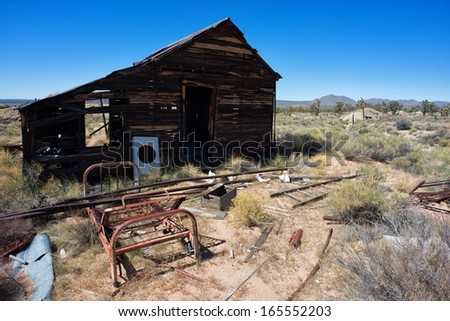 Very old abandoned house in the desert in black and white with film grain effect - stock photo