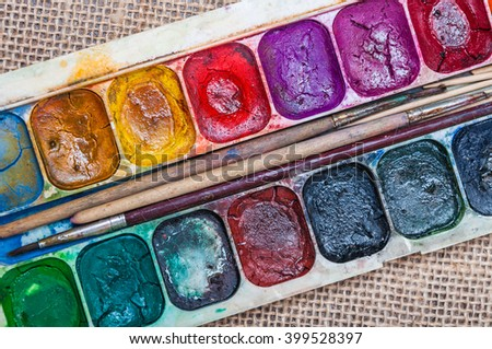 Very old and dusty watercolor paint - stock photo