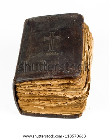 Very old bible book isolated on white - stock photo