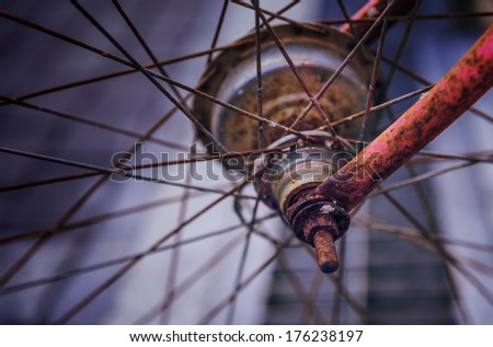 Very old bicycle wheel. - stock photo